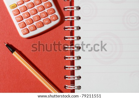 calculator and pen on open note book - stock photo