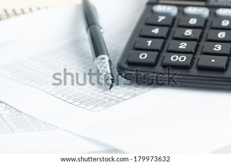 calculator and pen on the financial documents, abstract accounting business concept  - stock photo