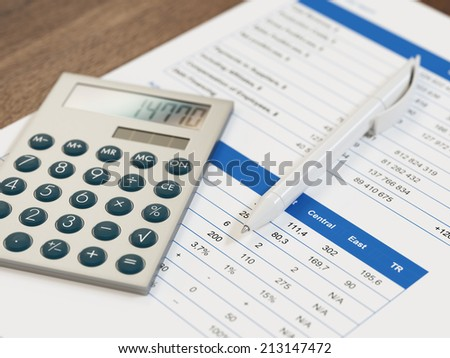 Calculator and pen on top of financial reports - stock photo