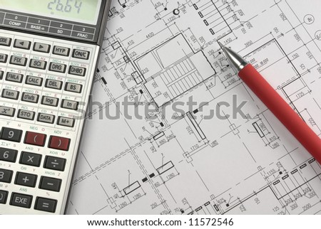 Calculator and red pencil on building design.