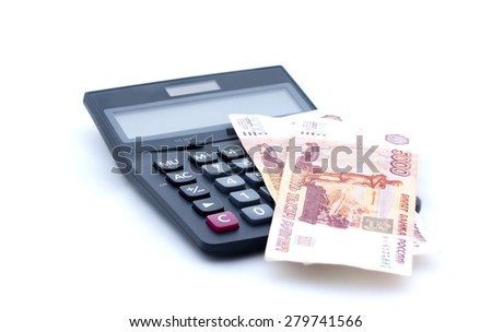 Calculator and russian banknotes on white - stock photo