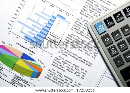 Calculator and stock market report with visual aids. - stock photo
