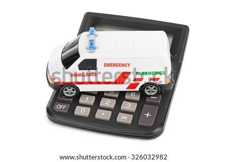 Calculator and toy medical car isolated on white background