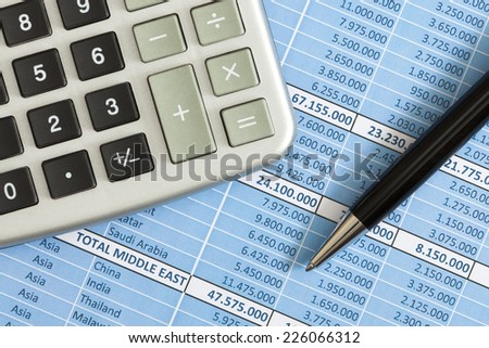 Calculator, biro and business reports as a concept of accounting - stock photo