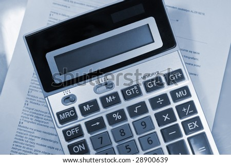 Calculator blue business concept background.