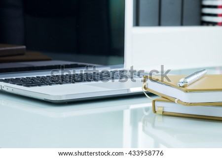calculator, business document and laptop computer notebook on table