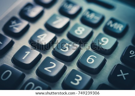 calculator button blue black background for business finance office or education top view close up