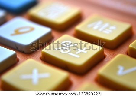 Calculator close-up shot focus on percentage - stock photo