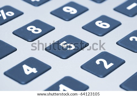 Calculator closeup with blue tones