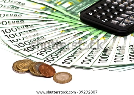 Calculator euro banknotes and coins isolated on white - stock photo