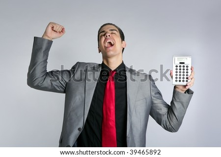 Calculator give good results to young businessman on gray background - stock photo