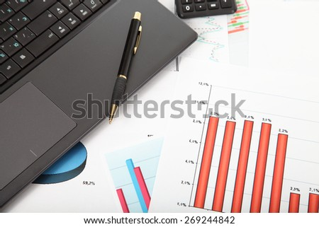 Calculator, laptop,tablet and financial documents on the table - stock photo