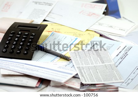 Calculator, legal pad and receipt book, paycheck and lots of bills