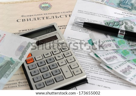 Calculator, money, pen and tax act against the background of the certificate close - stock photo
