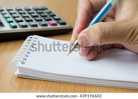 Calculator, notebook and pen for calculate  - stock photo