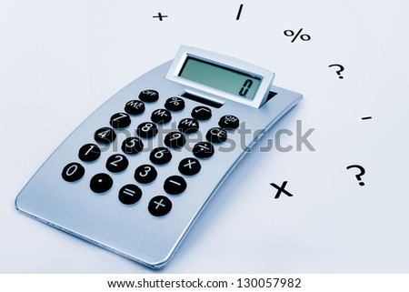 calculator on a white background with different symbols around - stock photo