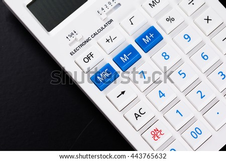 Calculator on black background