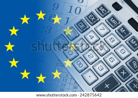 Calculator on calendar background with flag europe union - stock photo