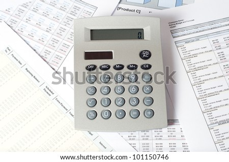 calculator on financial documents - stock photo