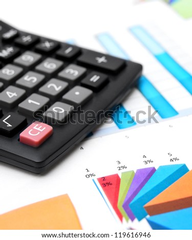 Calculator on graphs. - stock photo