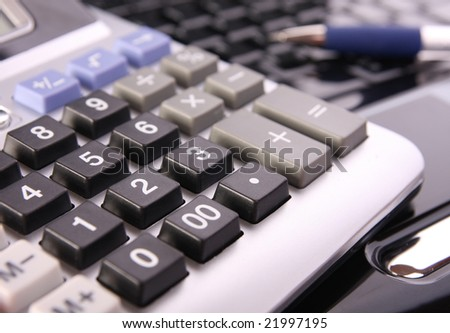 Calculator on laptop keyboard