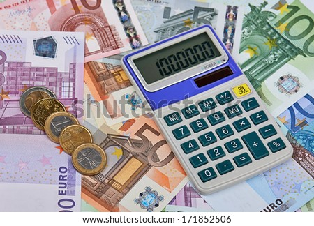 Calculator on the various euro banknotes. Displayed on the calculator numeral million. - stock photo