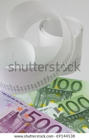 Calculator paper tape with euro bills - stock photo