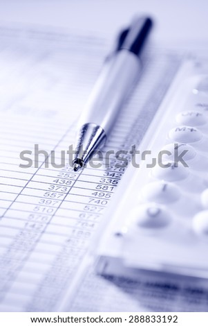calculator, pen and business papers on the desk in the office - stock photo