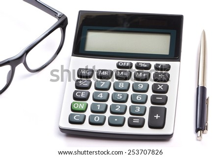 Calculator, pen and glasses isolated on white background - stock photo
