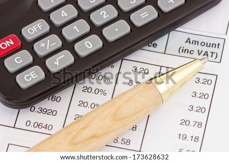 Calculator, pen and invoice with balance due - stock photo