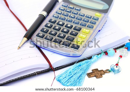 Calculator, pen and notebook  isolated on white background. - stock photo