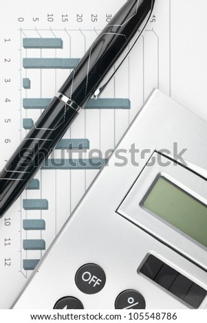 calculator, pen and paper with a diagram - stock photo
