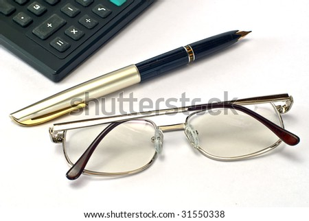 calculator, pen and spectacles on white