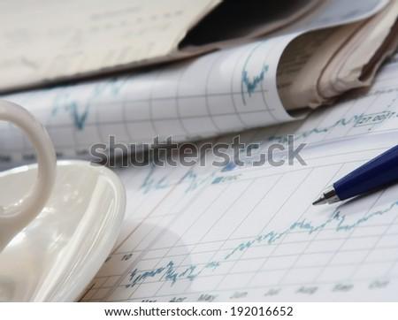 Calculator, pen, folder with documents, laptop - stock photo