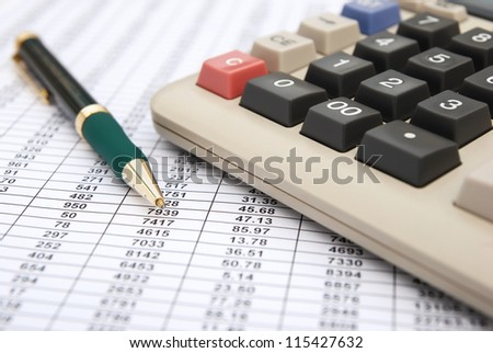calculator & pen on a chart background, business concept - stock photo