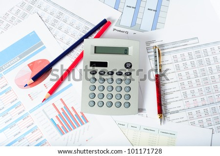 calculator pencils and pen over financial documents