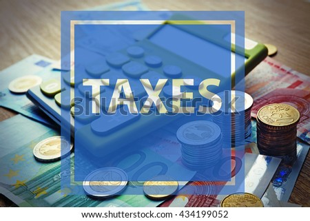 Calculator with banknotes and coins on wooden table.Taxes concept - stock photo