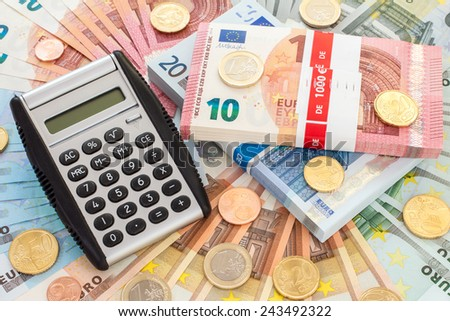 Calculator with Euro banknotes and coins. Finance concept. - stock photo
