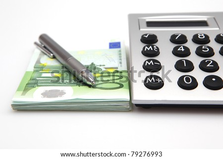 Calculator with euro bills and pen - stock photo