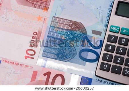 Calculator with money - stock photo