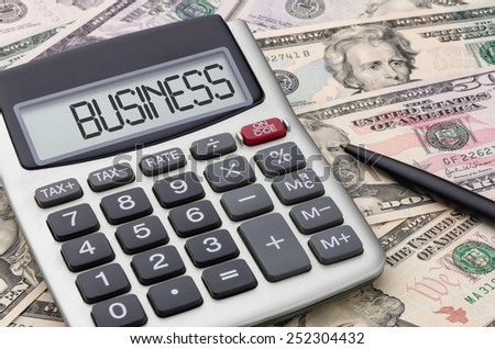 Calculator with money - Business - stock photo