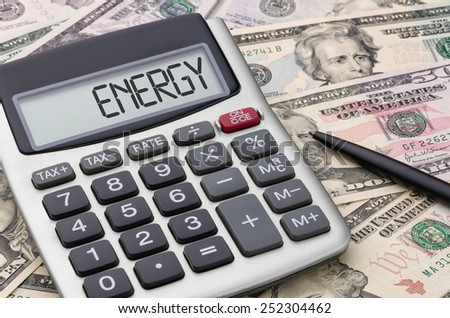 Calculator with money - Energy - stock photo