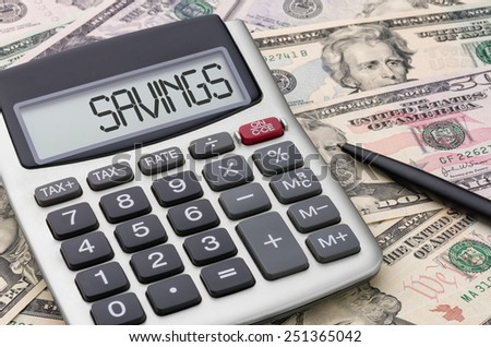 Calculator with money - Savings - stock photo