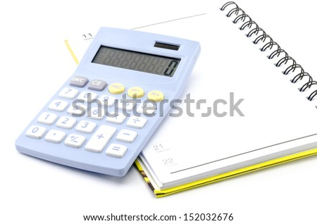 calculator  with notebook isolated on white background - stock photo