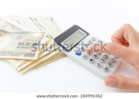 Calculator with paper money - stock photo