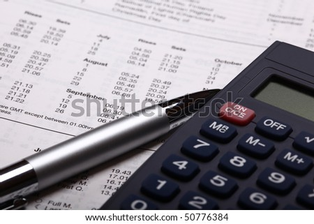 calculator with pen and calculations - stock photo