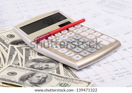 calculator with pen and dollars against estimates - stock photo