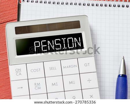 Calculator with pension word. Calculator with pension word and notepad, pen on background - stock photo