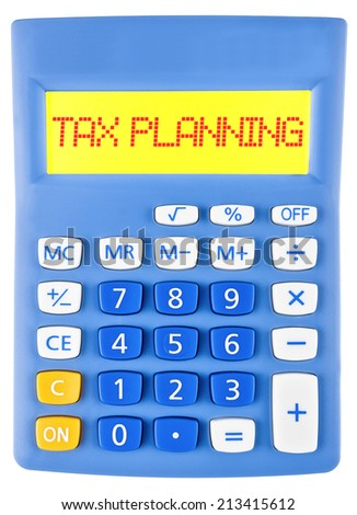 Calculator with TAX PLANNING on display on white background - stock photo