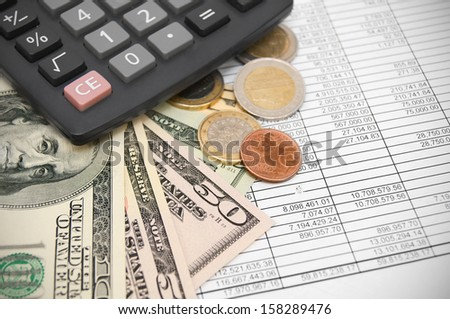 Calculators and money on documents.